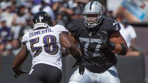 Elvis dumervil austin howard nfl baltimore ravens oakland raiders